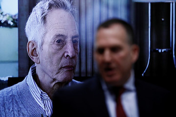 A photo of Robert Durst is shown as Deputy District Attorney John Lewin makes opening statements in the Robert Durst's murder trial in Los Angeles