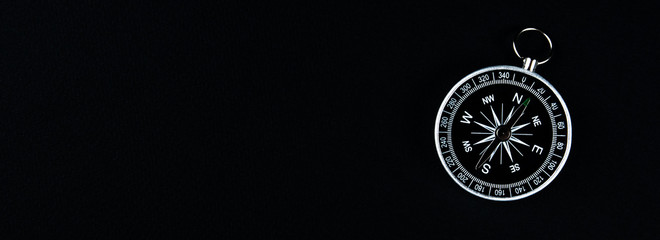 Old compass on a black background. Copy space for text or design Wall mural