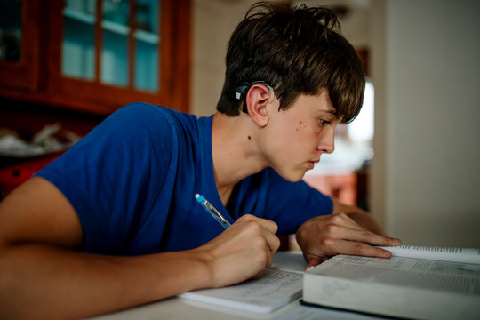 15 yr old boy with cochlear implant doing homework