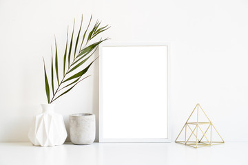 White frame and home decoration details on tabletop with wall, artwork poster mock-up