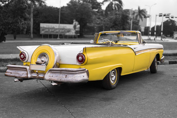colorkey of yellow and white old american classic car with fin tails in havana
