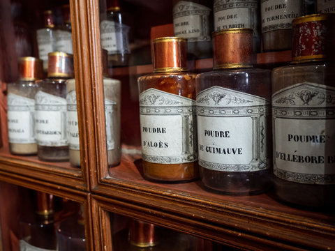 Vintage vials with ointments, infusions and powders, homeopathy. Medieval pharmacy.