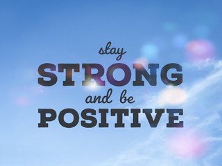 Photo sur Aluminium Positive Typography Stay strong and be positive word on blue sky colorful bokeh background