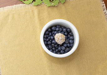 Blueberries with penaut butter ball with dates and coconut shrims