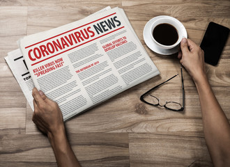 Mockup of Coronavirus Newspaper, News related of the COVID-19 with the the headline in paper media press production concept in businessman hands