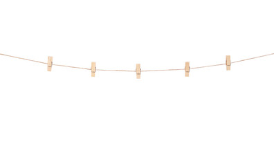 Wooden clothes pins hanging on brown rope  isolated on white background