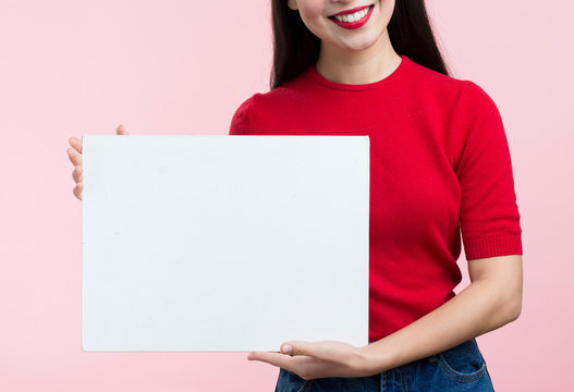Close-up woman holding blank paper sheet