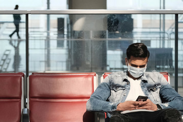 A passenger wears a protective face mask at the airport, following the outbreak of the new coronavirus, in Hong Kong
