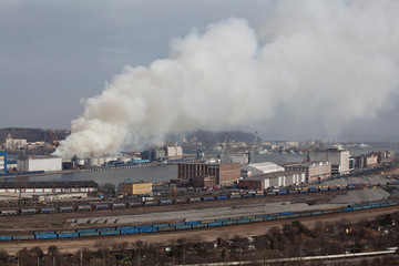 Smoke rises in the air as a grain warehouse is on fire in the port of Gdynia