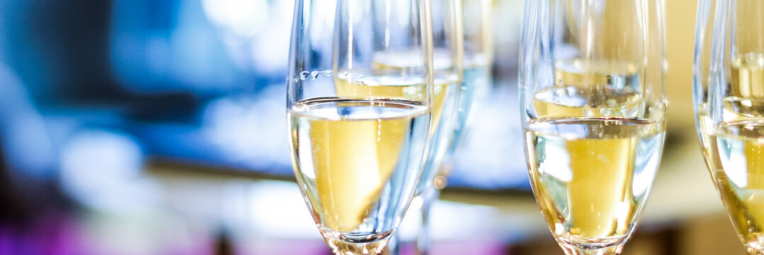 Glasses of champagne and sparkling wine served on a tray at charity event