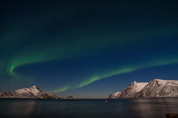 Photo sur Toile Aurore polaire polar lights, Aurora borealis over the mountains in the North of Europe - Lofoten islands, Norway