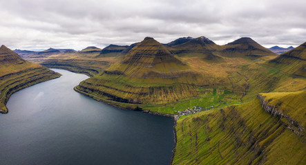 Wall Mural - Aerial view of mountains and ocean around village of Funningur on Faroe Islands