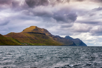 Wall Mural - Village of Sydradalur and the island of Kalsoy in Faroe Islands, Denmark