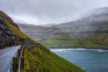 Wall Mural - Road going to the village of Tjornuvik in the Faroe Islands, Denmark