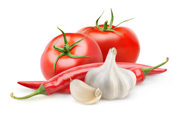 Isolated vegetables. Fresh tomatoes, garlic and chili pepper (arrabbiata souce ingredients) isolated on white background with clipping path