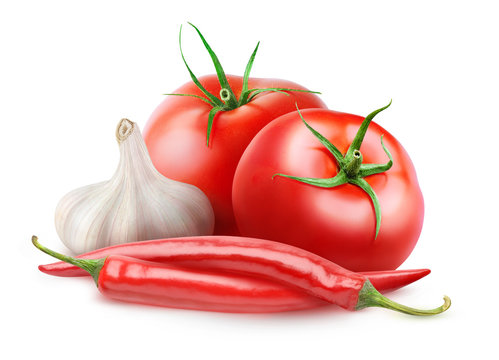 Isolated arrabbiata sauce ingredients. Two fresh tomatoes, red hot peppers and a head of garlic isolated on white background with clipping path