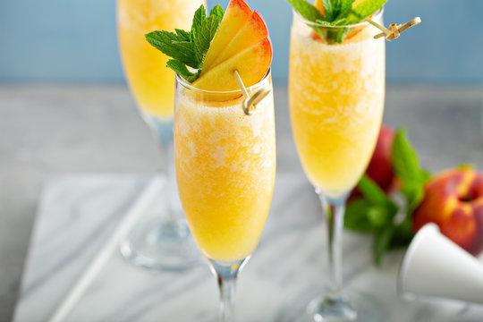 Summertime peach mimosas or bellinis