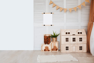 Stylish scandinavian  baby room with  wooden toys and  posters on wall. zero waste. eco-friendly materials