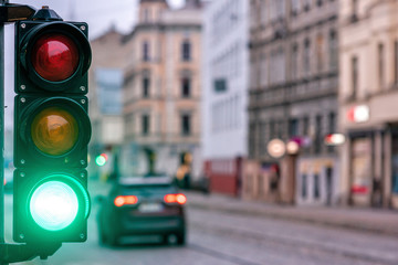 A city crossing with a semaphore. Green light in semaphore
