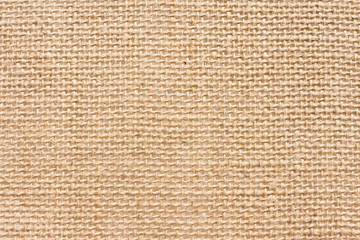 Fototapeta The texture of the rough linen fabric. Light rustic background. Natural material