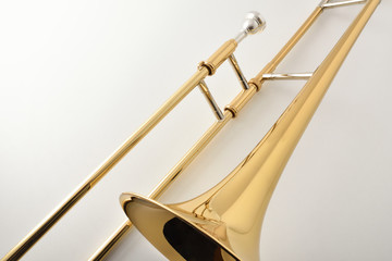 Braces and mouthpiece of a trombone on white table