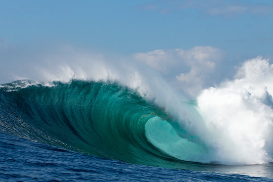 Perfect big blue breaking wave