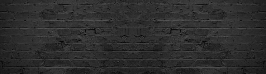Spoed Foto op Canvas Baksteen muur Dark black anthracite damaged rustic brick wall texture banner panorama
