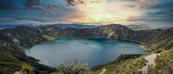 Amazing sunset at Quilotoa lake, located inside a volcano crater. Ecuador, South America