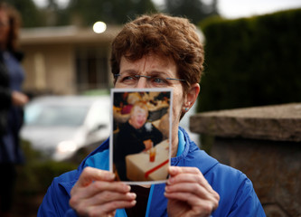 Herrick holds up a picture of her mother Elaine, who passed away this morning at the Life Care Center of Kirkland