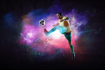 Boy playing soccer hitting the ball