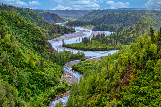 River Flowing Through a Valley in Boreal Forest, Alaska, USA