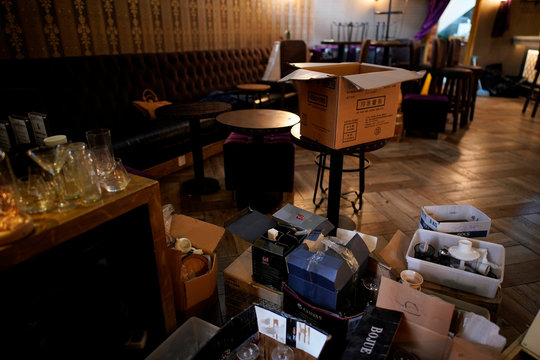 Boxes of cooking equipment and tools are seen inside Barules, a cocktail bar that has been shut for good following the novel coronavirus outbreak, in Shanghai