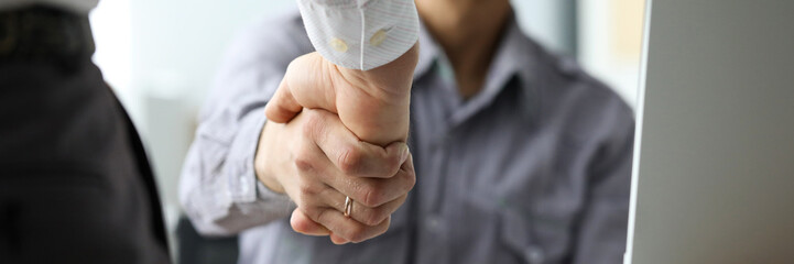Two male clerks shaking hands at workplace close-up. Symbol of beginning of new positive promising relationship for future opportunities concept Fototapete