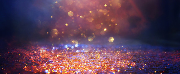 Fototapete - background of abstract glitter lights. gold, blue and black. de focused