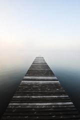 Wooden jetty in misty water, Yxningen, Åtvidaberg, Östergötland, Europe