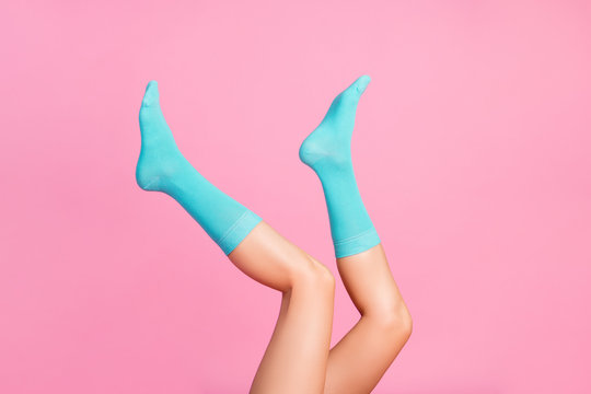 Cropped view of nice attractive long lovely healthy legs wearing bright blue socks girlfriend 8 March day holiday sale discount isolated over pink pastel color background