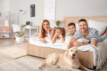 Happy family with dog in bedroom at home