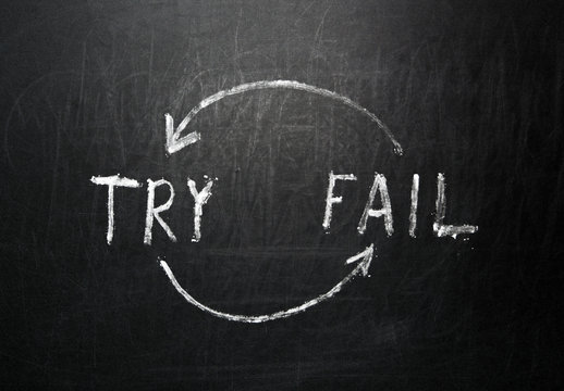 Try and Fail Iteration Handwritten on black chalkboard