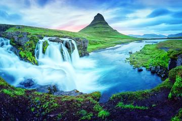 Unique landscape with Kirkjufellsfoss waterfall and Kirkjufell mountain, Iceland, Europe.
