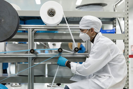 Workers are using polypropylene as a raw material to produce meltblown cloth for medical-surgical masks.COVID-19 Coronavirus outbreak