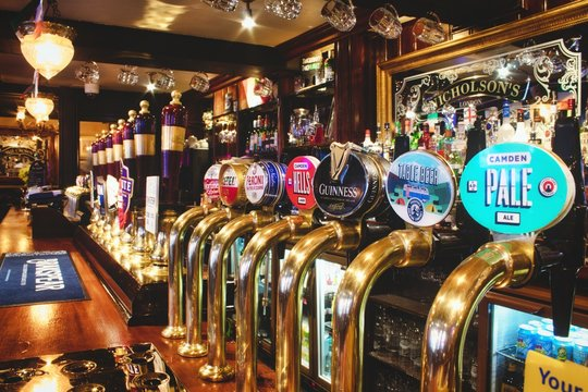 Oxford, UK - 02 March 2020: Rows of draught beer in a typical British pub (Nicholson's of London chain)