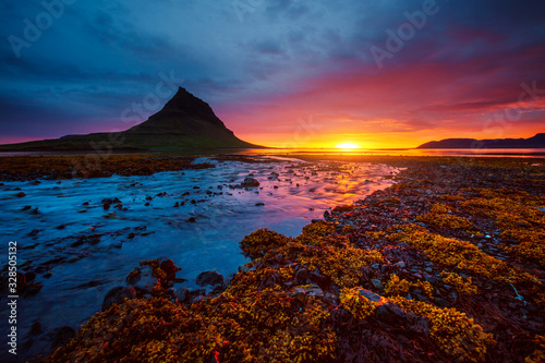 Wall mural Great sunset over the Atlantic ocean. Location place Kirkjufell volcano the coast of Snaefellsnes peninsula, Iceland, Europe.