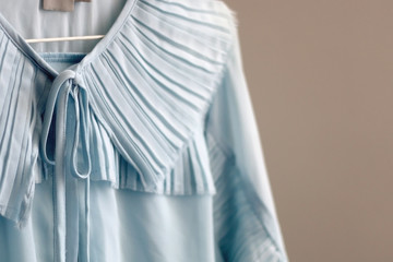 Feminine light blue dress on a clothing rack. Selective focus. Fotobehang