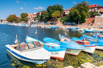 fishing boats in port on a sunny day