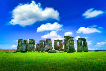Wall Mural - Stonehenge an ancient prehistoric stone monument on blue sky background at Wiltshire, UK.