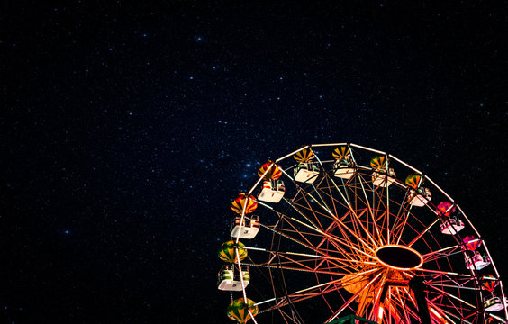 Ferris wheel on a background of the starry night sky