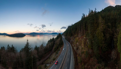 Wall Mural - Sea to Sky Hwy in Howe Sound near Horseshoe Bay, West Vancouver, British Columbia, Canada. Aerial panoramic view during a colorful sunrise in Winter Season. Panorama