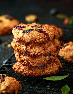 Home made Blueberry and walnut oat cookies on black background