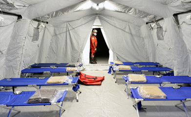 Empty hospital field tent for the first AID, a mobile medical unit of red cross for patient with Corona Virus. Camp room for people infected with an epidemic.