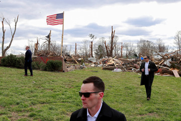 U.S. Secret Service agents stand by as U.S. President Trump observes tornado damage in Cookeville, Tennessee
